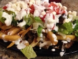 Griekse loaded fries met feta en kruiden